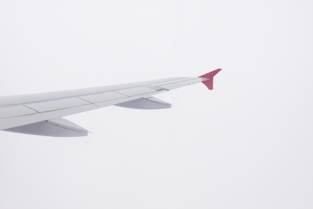 Wing of airplane on white background.