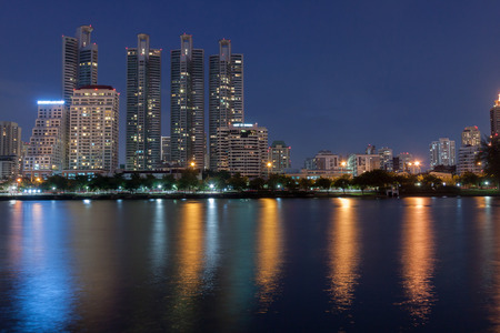 Twilight time at the business district from Benjakiti Park  Bangkok , Thailand