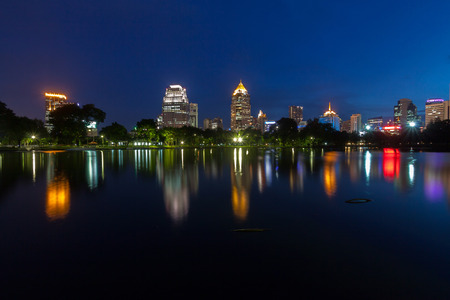 Twilight time at the business district from Lumpini Park  Bangkok , Thailand