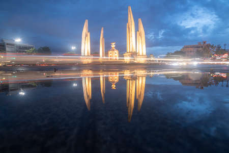 Reflection of Democracy Monument at twilight time at Bangkok,Thailand