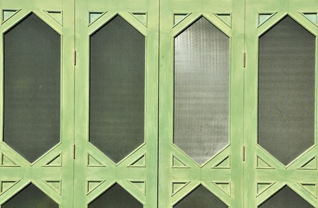 This is a foldable door of one of the residence in Sanam Chandra Palace, Thailand photo