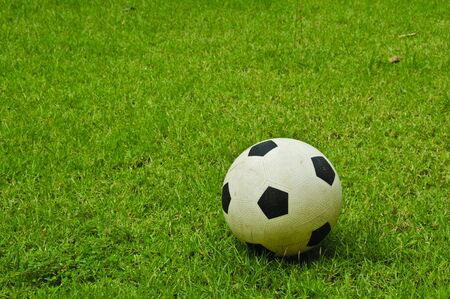 Soccer ball is on a grass field in the afternoon. Stock Photo - 7110810