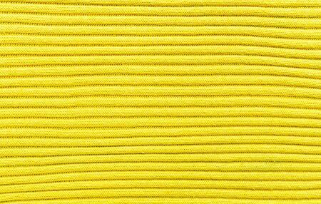 wool fiber: Su�ter amarillo textura o motivo  Foto de archivo