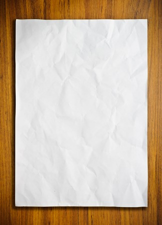 White paper on wood floor photo