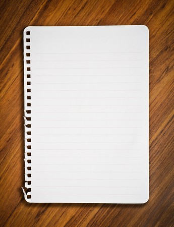 notebook paper on wood floor Stock Photo - 7705386