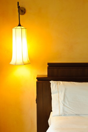 A bed with a wall lamp, Thailand photo