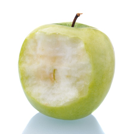 bitten green apple on white background with reflection photo