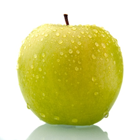 Green apple on white background with reflection and drop of water. Stock Photo - 8988165