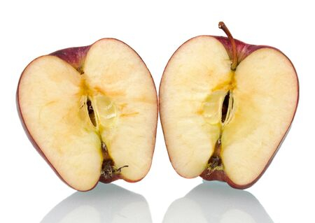 red apple cut in half on white background photo