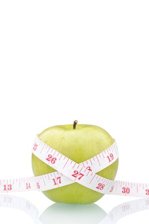 green apple and  measure tape isolated on white Stock Photo - 9137998