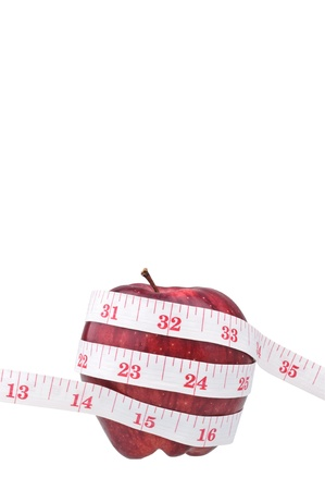 red apple and measure tape with copy space Stock Photo - 9137994