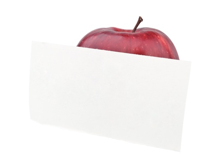 red apple and a note isolated on white Stock Photo - 9137988