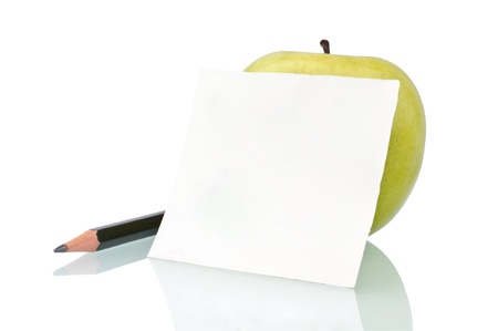 Green apple, a pencil and a note isolated on white Stock Photo - 9137997