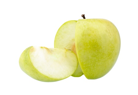 Green apple and a slice isolated over a white background photo