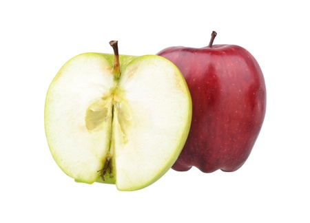 One red and a half of green apples isolated on white photo