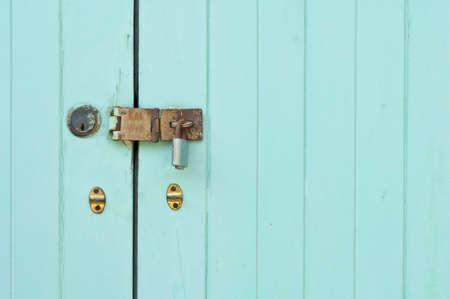 Door lock and green door as a background Stock Photo - 9302066