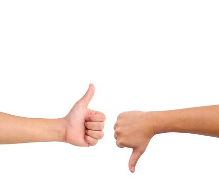 Thumb up and thumb down hand signs isolated on white with a copy space Stock Photo - 9407062
