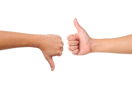 Thumb up and thumb down hand signs isolated on white Stock Photo