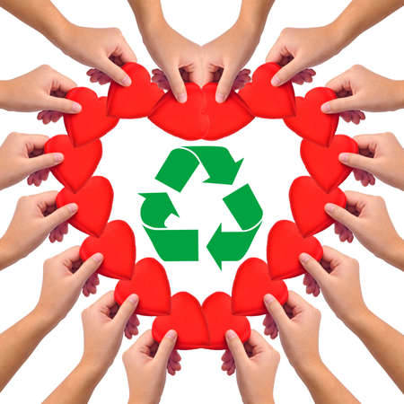 Conceptual image, love recycling. hand with heart isolated on white with recycle icon in the middle. photo