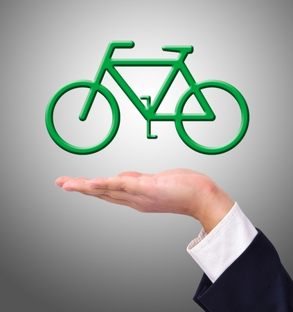 Conceptual image, Business man help the environment by riding a bike and have  photo