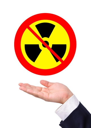 Conceptual image, caring for radioactive usage. Business man care for prohibition of radioactive usage. Stock Photo - 9801028
