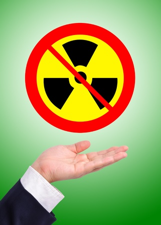 Conceptual image, caring for radioactive usage. Business man care for prohibition of radioactive usage. photo