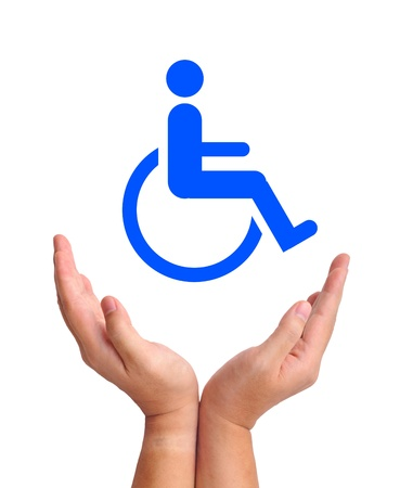 Conceptual image, care for handicapped person. Two hands and wheelchair icon on white background. photo
