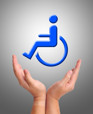 Conceptual image, care for handicapped person. Two hands and wheelchair icon on grey background.