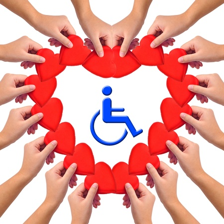 Conceptual image, Love handicapped person. Hands with hearts isolated on white with blue wheelchair icon in the middle. Stock Photo - 9801045