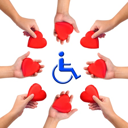 Conceptual image, Love handicapped person. Hands with hearts isolated on white with blue wheelchair icon in the middle. photo