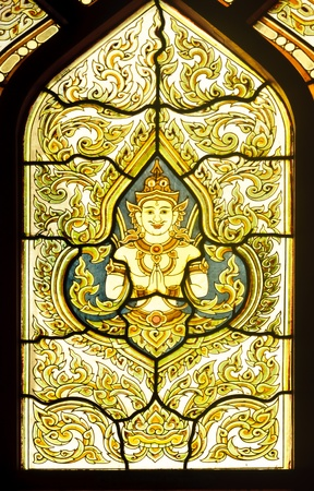 Thai traditional painting glass as a temple window at the marble temple, Bangkok. photo