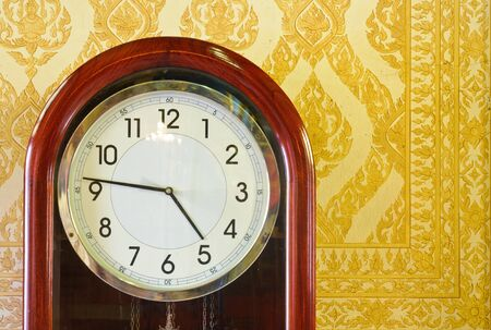 Antique clock in the Marble temple. photo