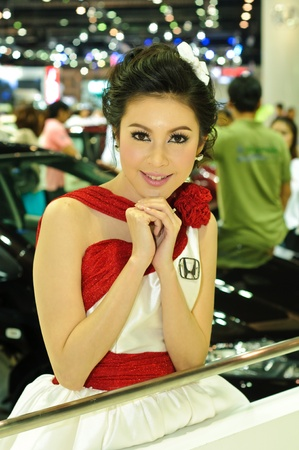 BANGKOK - DECEMBER 7: Female presenters model at Honda booth during Thailand International Motor Expo 2011 at Impact Challenger on December 7, 2011 in Bangkok, Thailand. Stock Photo - 11401157
