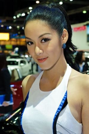 BANGKOK - DECEMBER 7: Female presenters model at BMW booth during Thailand International Motor Expo 2011 at Impact Challenger on December 7, 2011 in Bangkok, Thailand. Editorial