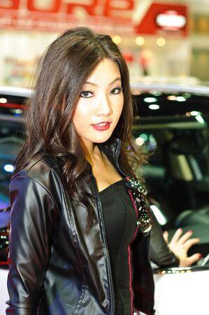 BANGKOK - DECEMBER 7: Female presenters model at Mini car booth during Thailand International Motor Expo 2011 at Impact Challenger on December 7, 2011 in Bangkok, Thailand. Stock Photo - 11401164