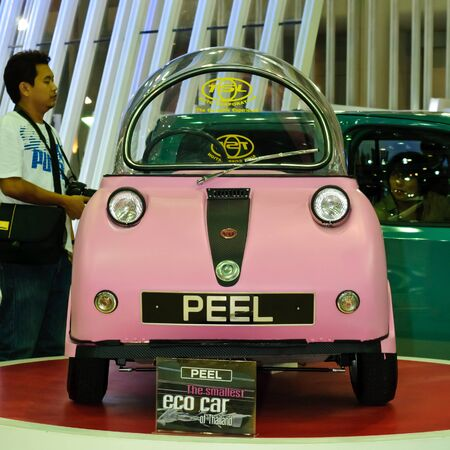 smallest: BANGKOK, THAILAND-DECEMBER 07: Peel, the smallest eco car of Thailand, on display at Thailand International Motor Expo 2011 on December 07, 2011 in Bangkok, Thailand.