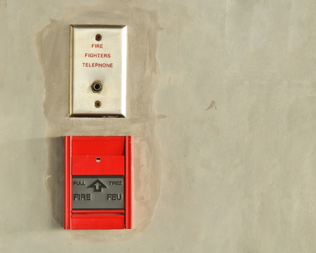 fire alarm on concrete wall. photo