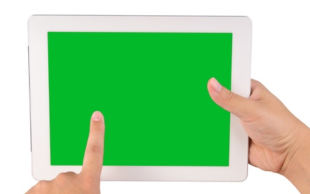 Hand holding a tablet computer with blank green screen Isolated on white photo