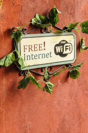 Free Internet sign on redish brown wall Stock Photo - 13359239