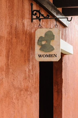 Womens public toilet sign in front of an entrance. photo