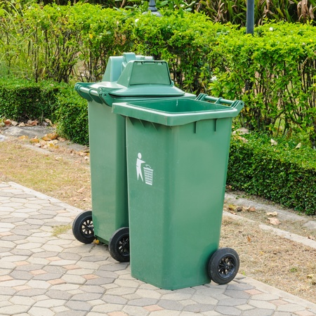 Green Plastic Waste Container In The Park photo
