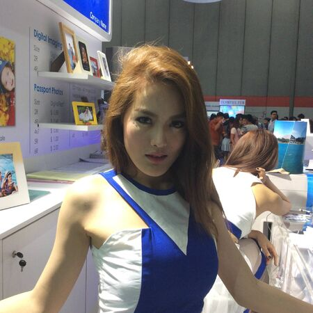 sexy asian girl: A female presenter of a product at Thai photo fair, Thailand