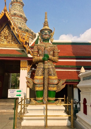 shiny: Thai giant statue at the temple of the emerald Buddha , Thailand