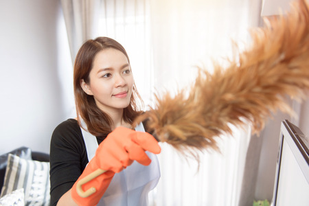 Asian young maid cleaning at home, Cleaning service concept Stock Photo