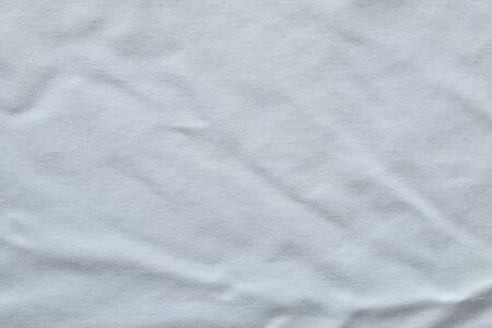 Wrinkled White fabric close up shot of good quality Cotton and polyester shirt. formal wear for office worker . Background texture concept with copy space for text.