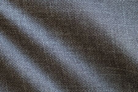 Selective focus, Close up shot of dark grey formal suit cloth textile surface. wool fabric texture for important luxury evening or night event. Wallpaper and background with copy space for text