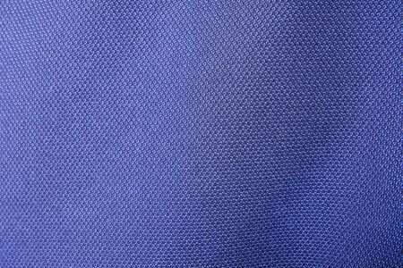 Close up shot of midnight dark blue formal suit cloth textile surface. wool fabric texture for important luxury evening or night event. Wallpaper and background with copy space for text Archivio Fotografico