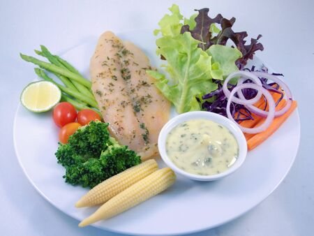 Fishsteak,vegetable and seasoning sauce       Stock Photo