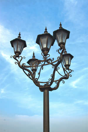 Street lamp on a blue sky background  photo