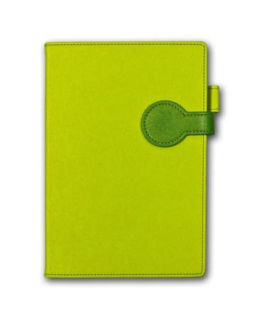 Un livre vert isol� sur fond blanc